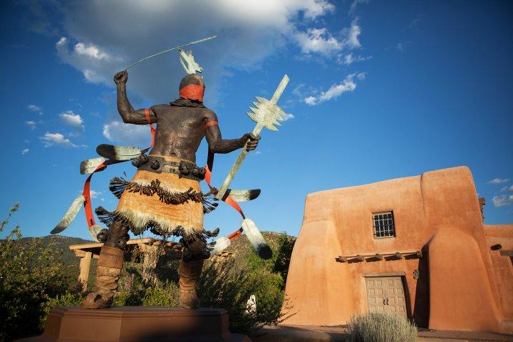 Pueblo style home and sculpture in Santa Fe, New Mexico