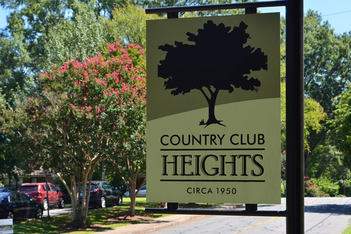 Sign at the entrance of neighborhood reading 'Country Club Heights'