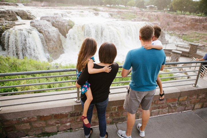 Family of four overlooking the falls in Sioux Falls, South Dakota