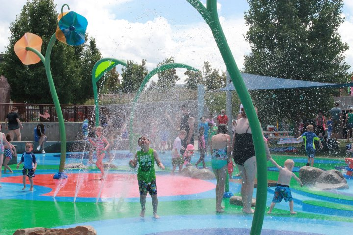 children and parents playing at a water park in Centennial, Colorado