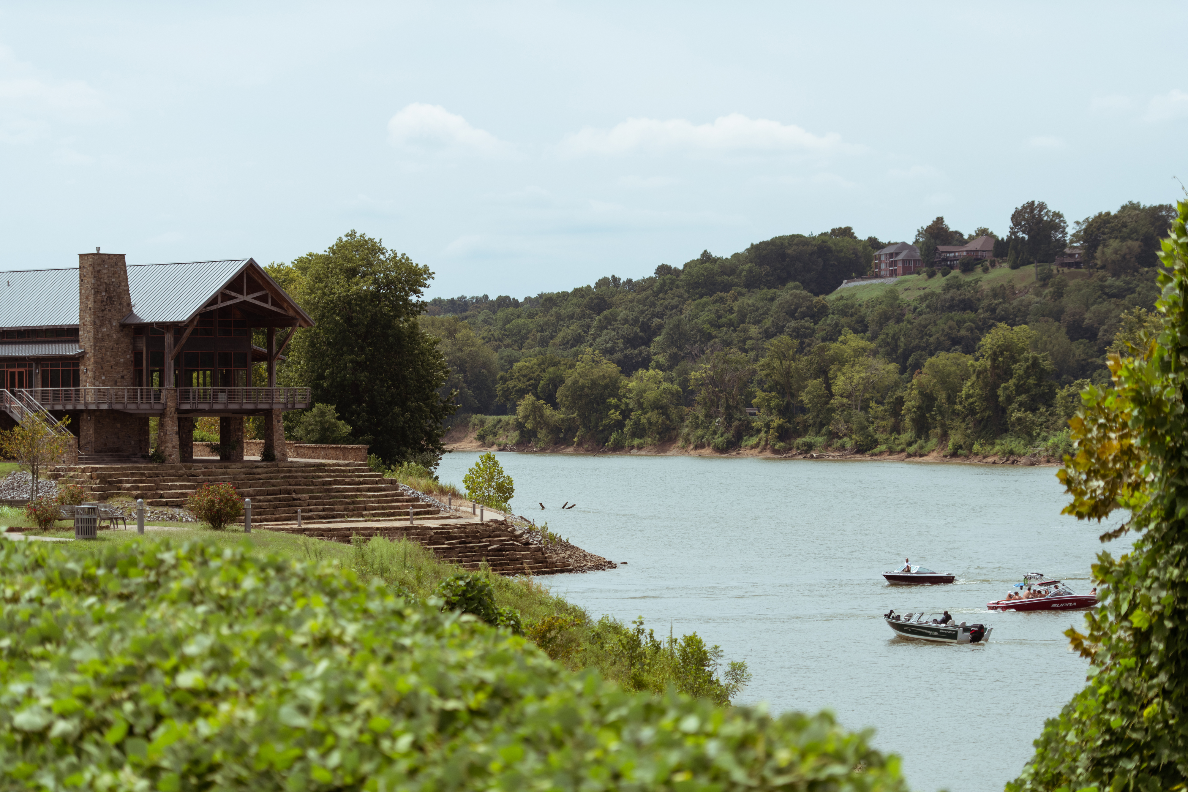 Boats sailing down the Cumberland River are visible from Clarksville's Riverwalk Trail.