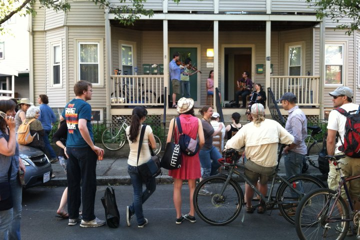 Neighbors gathered outside a house for a party in Somerville, Massachusetts