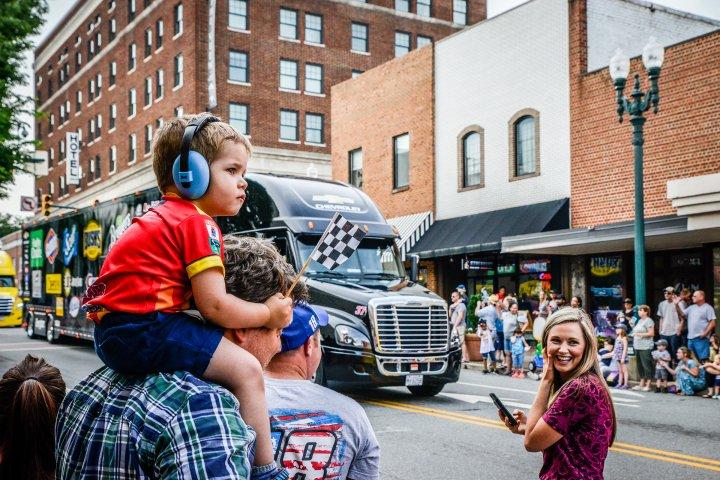 Boy on dad's shoulders in downtown Concord, North Carolina