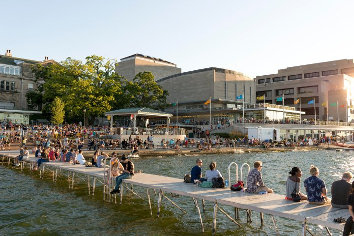 People sitting on the dock of Madison, Wisconsin lakefront