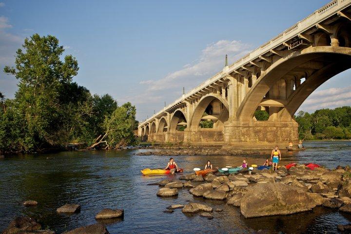 Kayakers under a bridge in Columbia, South Carolina