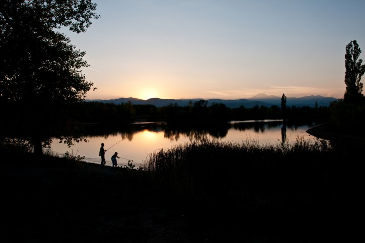 Two people fishing at sunset in longmont, colorado