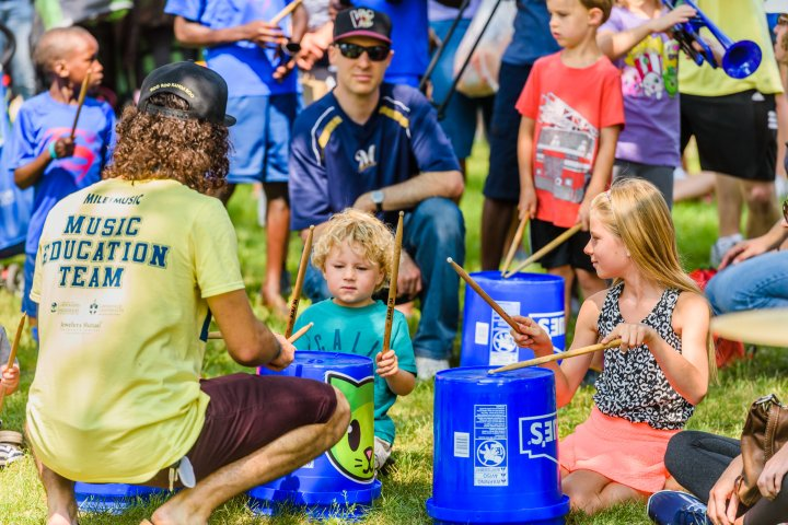 Children performing music with buckets in Appleton, Wisconsin