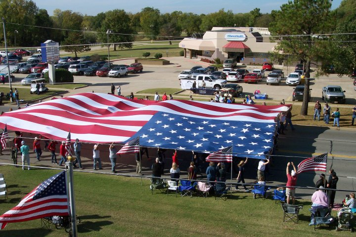community holding large american flag in Midwest City, Oklahoma