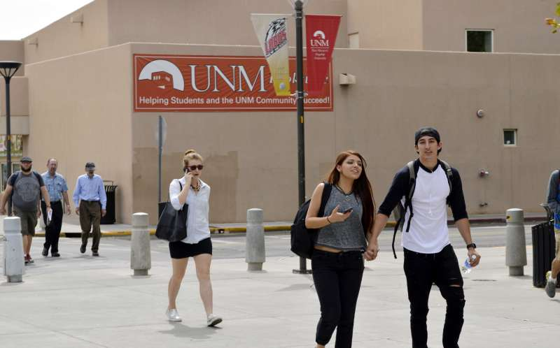 Mandatory Credit: Photo by Russell Contreras/AP/Shutterstock (6084098a)             Students walk on the campus of the University of New Mexico in Albuquerque. Efforts to make college more accessible in New Mexico and a handful of other states by tapping lottery proceeds are in jeopardy as tuition rises, state budgets falter and ticket sales slump. Tens of thousands of students in New Mexico could see their tuition assistance slashed by 30 percent in 2017 if nothing is done. Colleges in New Mexico are seeing declining enrollment and administrators says they are trying to adjust to the changing landscape             Lottery-Scholarship Programs, Albuquerque, USA