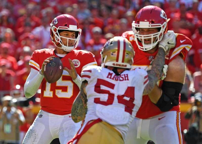 Patrick Mahomes of the Kansas City Chiefs drops back to pass against the San Francisco 49ers on September 23, 2018 at Arrowhead Stadium in Kansas City, Missouri.