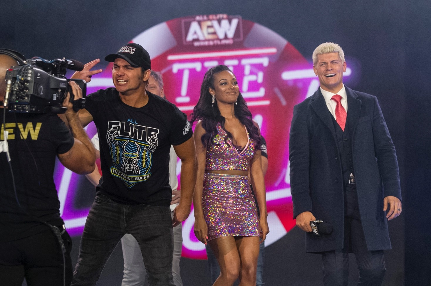Nick Jackson, Brandi Rhodes (center), and Cody Rhodes at an All Elite Wrestling event.