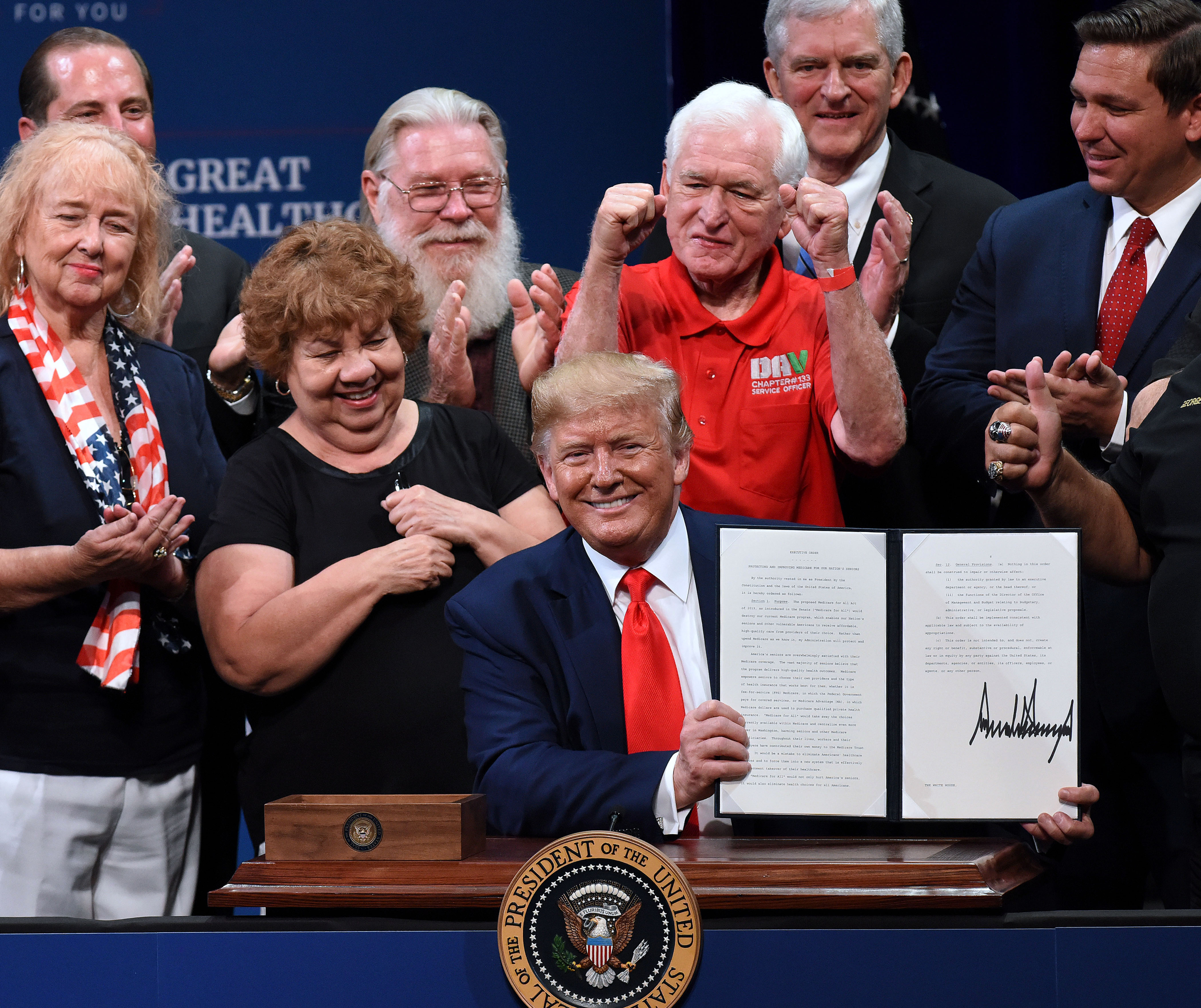 THE VILLAGES, FLORIDA, UNITED STATES - 2019/10/03: U.S. President Donald Trump signs an executive order to protect and improve Medicare at the Sharon L. Morse Performing Arts Center.