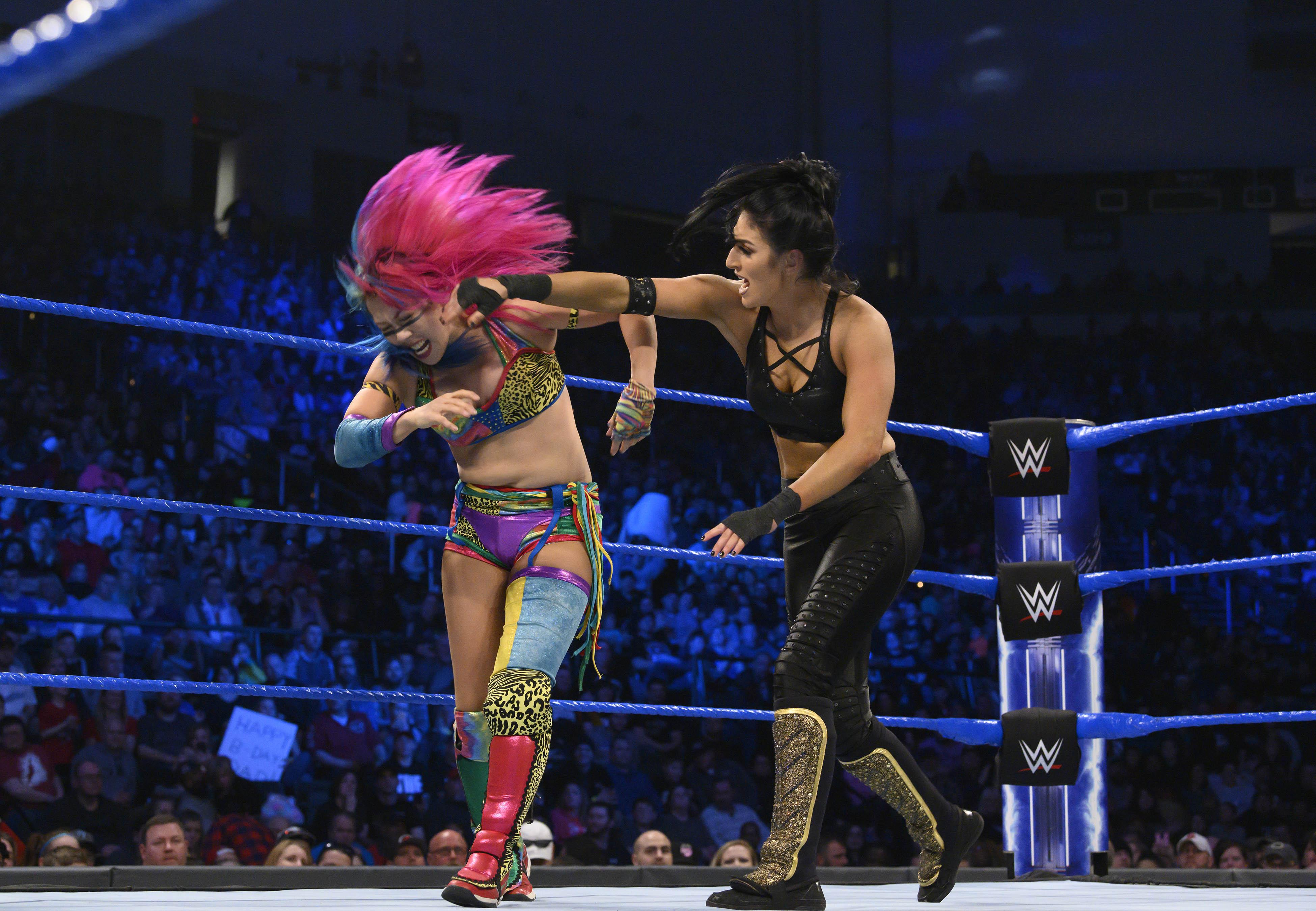 Daria Berenato (right) AKA  Sonya Deville  battles  Asuka  at a WWE SmackDown event in March 2019