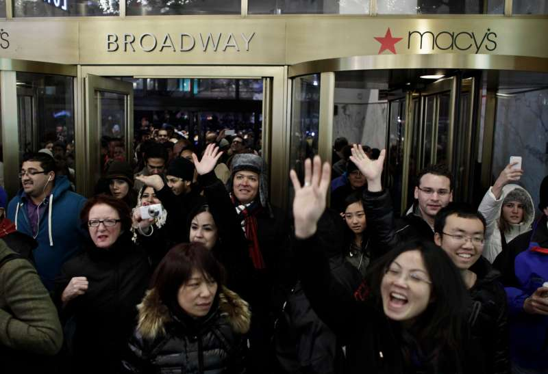 People enter Macy's Herald Square as the store opens on Thanksgiving Day.