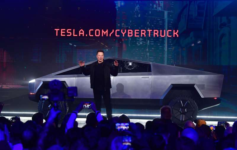 Tesla co-founder and CEO Elon Musk speaks in front of the newly unveiled all-electric battery-powered Tesla Cybertruck.