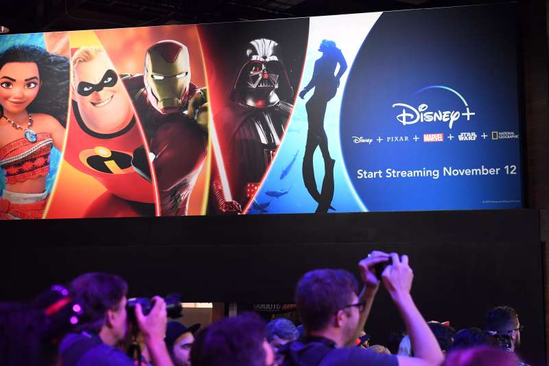 Attendees visit the Disney+ streaming service booth at the D23 Expo on August 23, 2019 at the Anaheim Convention Center in California.