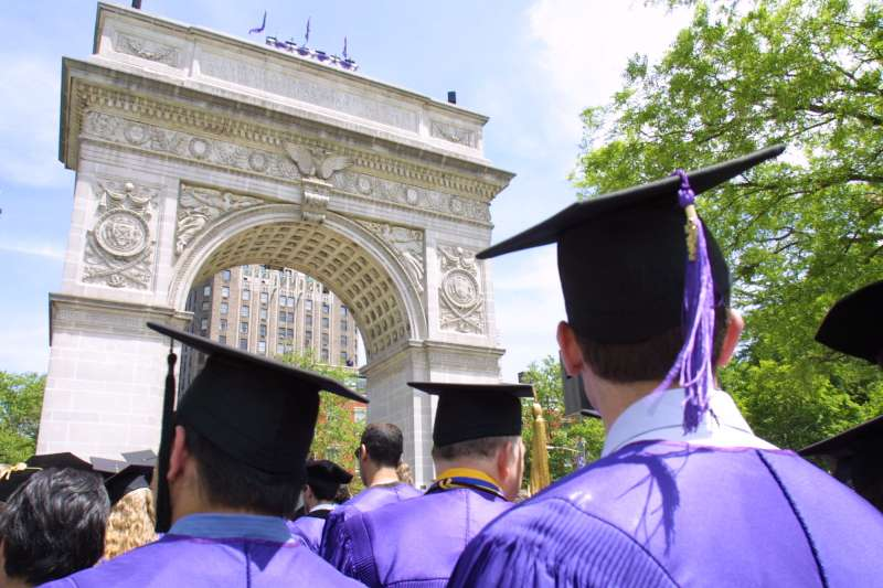 Photo by Tina Fineberg/AP/Shutterstock; a graduation ceremony at NYU