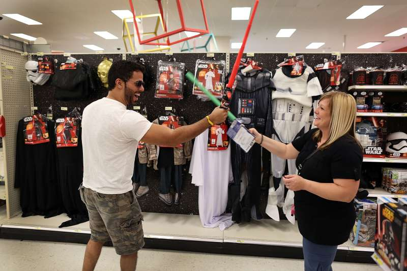 Target shoppers playing with Star Wars toys.