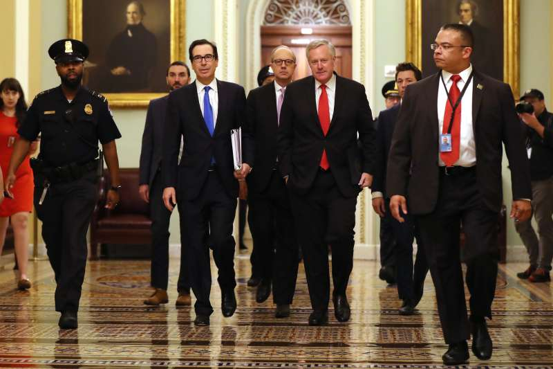 WASHINGTON, DC - MARCH 24:  Treasury Secretary Steven Mnuchin (2L), White House Director of Legislative Affairs Eric Ueland (3L) and White House Chief of Staff Mark Meadows (4L) arrive at the U.S. Capitol.