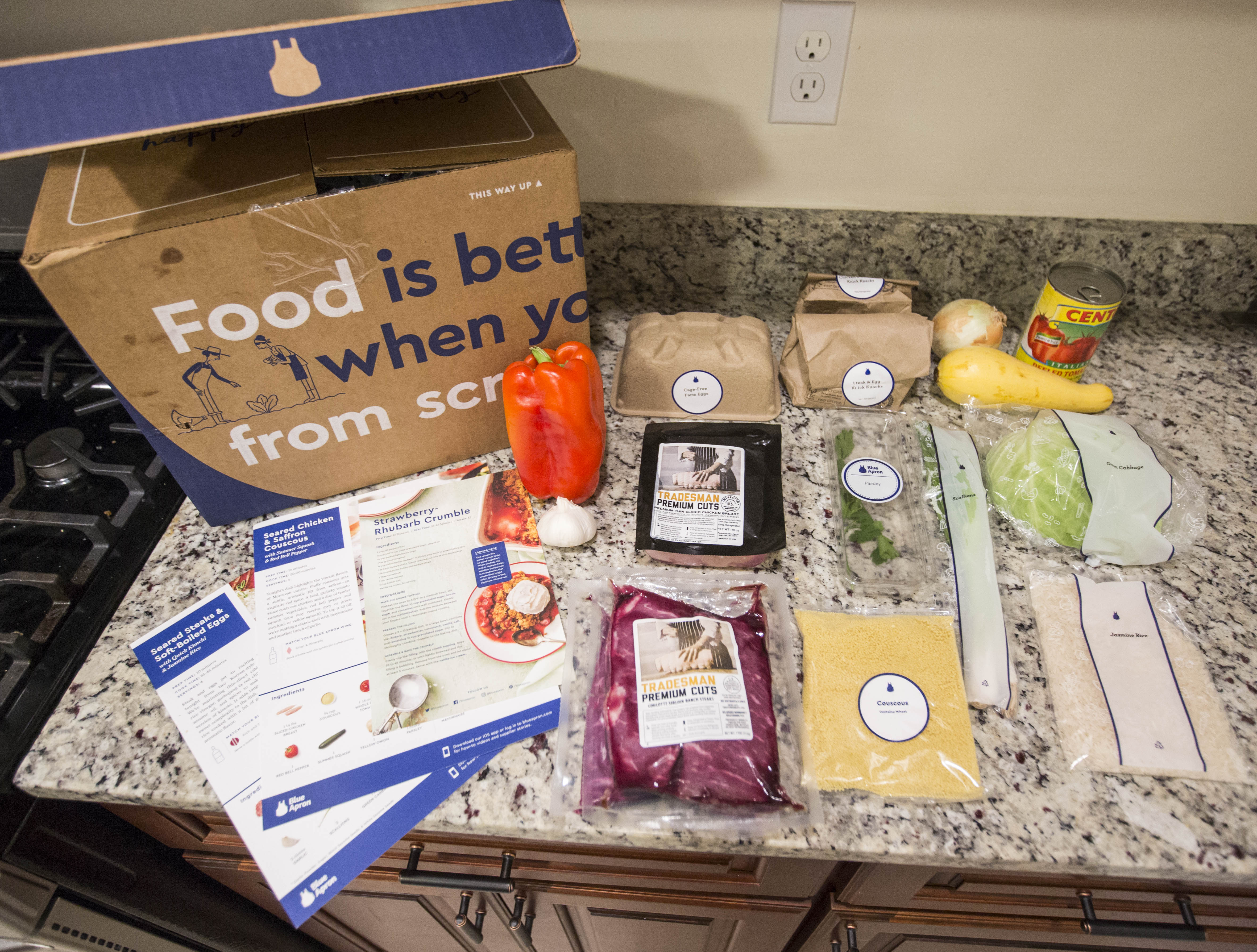 Items from a  family-plan  Blue Apron meal kit box.