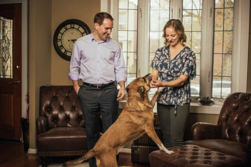 Chris and Danielle Betz with their dog Leo at their home in Washington, D.C., on March 6, 2020.