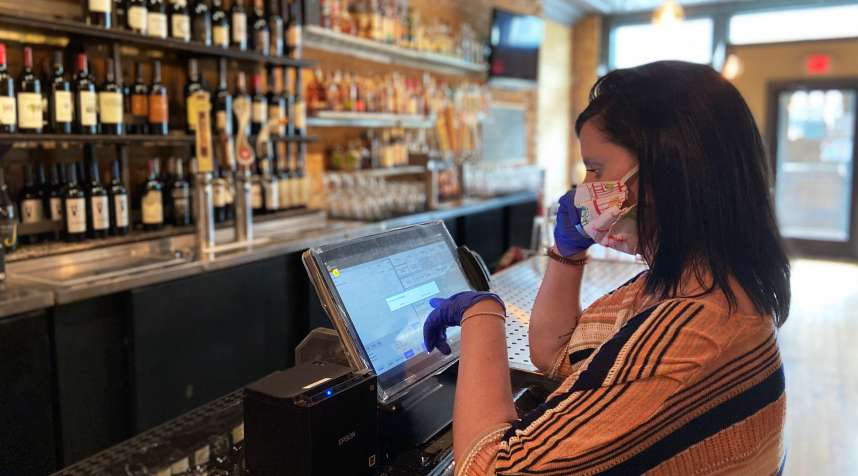Claire Zielinski works a restaurant shift in Bay City, Michigan on June 9, 2020. She's one of thousands of Americans enrolled in a little-known federal program that helps workers qualify for unemployment insurance after they return to work.