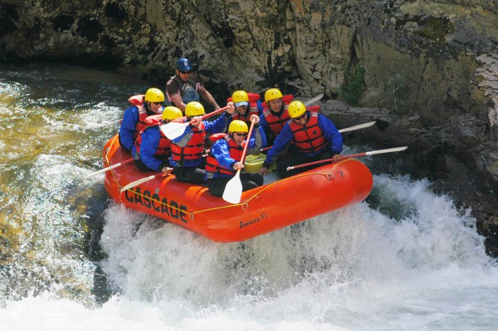 A group of people river rafting in Boise Idaho