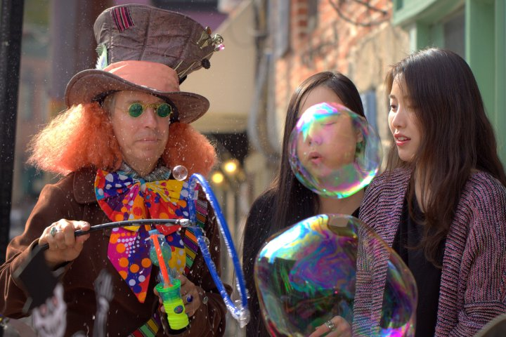 Bubble Man enchants onlookers with colorful soap bubbles in Ellicott City Maryland