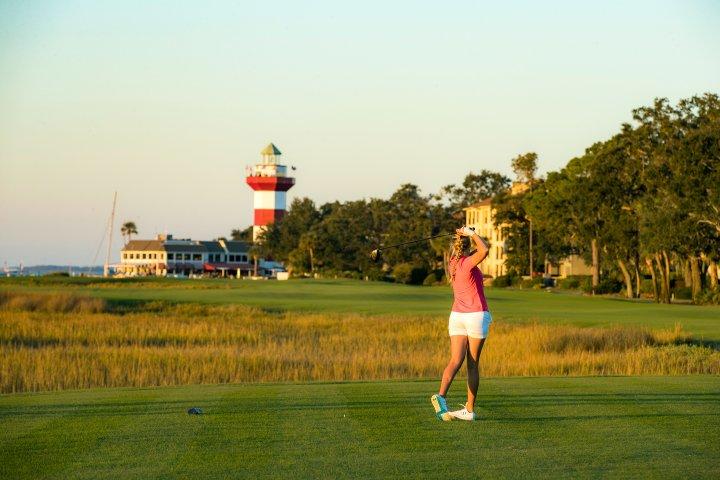 A young woman plays golf at Hilton Head Island South Carolina