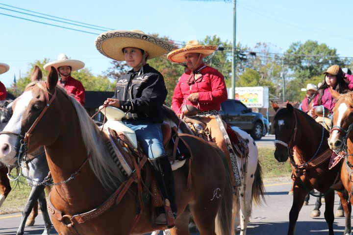 A group of people horseback ride through the streets in La Vergne Tennessee