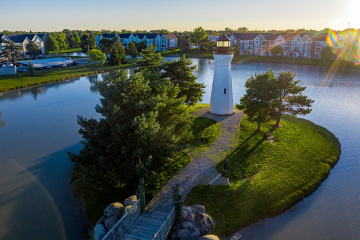 Aerial photo of a lighthouse on a manmade island in Macomb Michigan