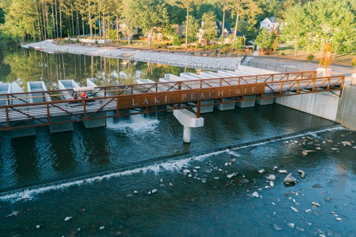 Aerial view of a golf cart crossing the bridge at Lake Peachtree in Georgia