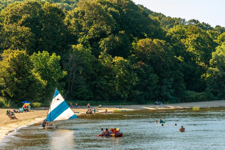 People enjoy the water at a beach in Plainview New York
