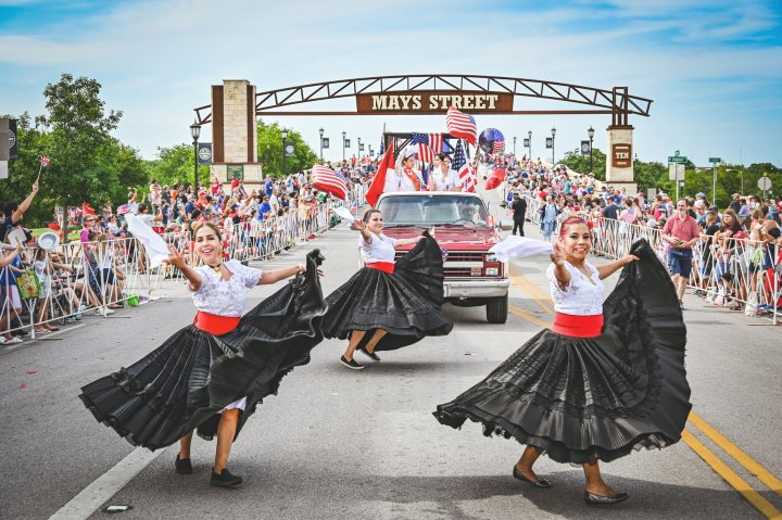 Dancers perform for a big crowd during the 4th of July street parade in Round Rock Texas