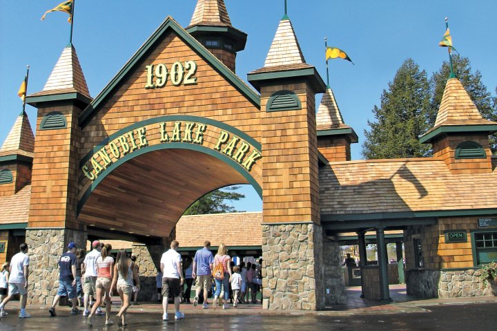 People walk in through the main entrance at Canobie Lake Park in Salem New Hampshire